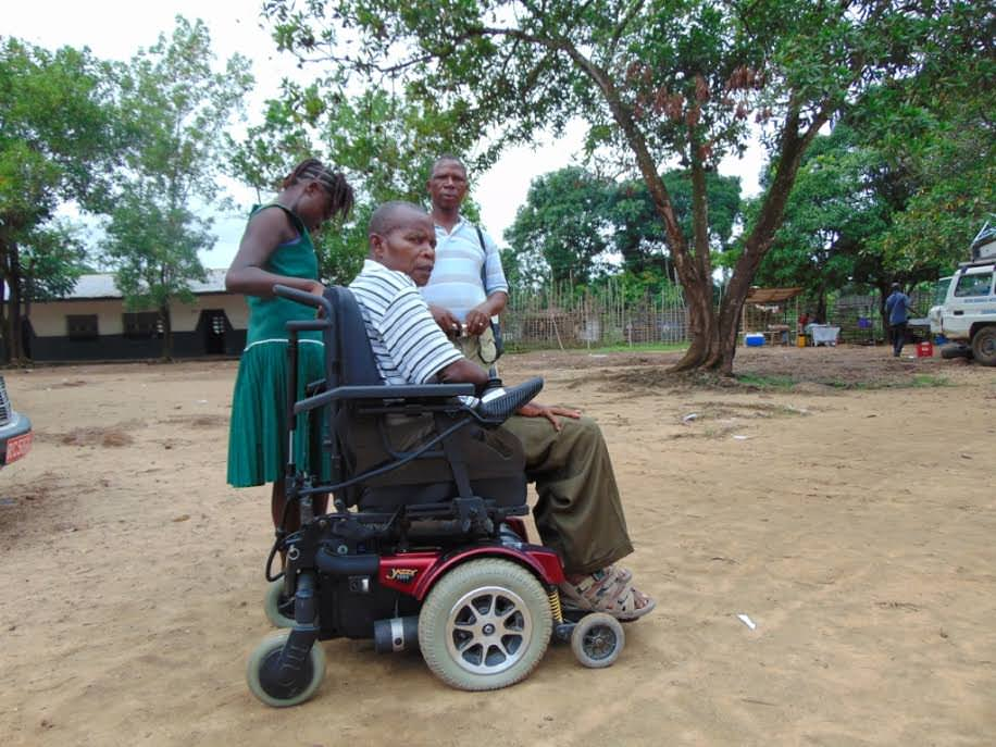 Mr Lansana, a disabled school teacher in his new motorized wheelchair in Kenema.