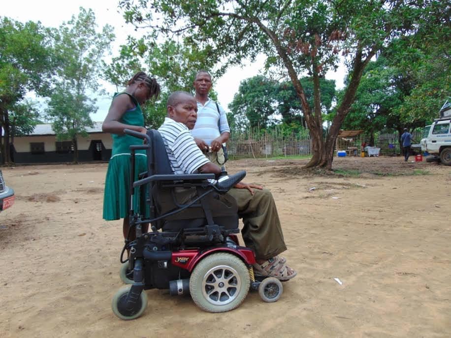 Mr Lansana, a disabled school teacher in his new motorized wheelchair in Kenema.