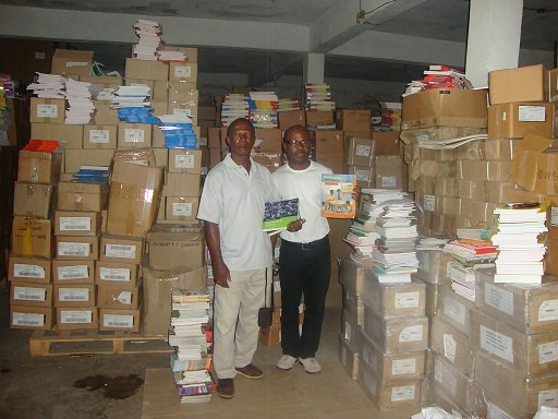 Programme Director - James Fallah-Williams (right) and Eastern Regional Project Coordinator – Osman Saffa (left) at the STAR Books, West Africa's warehouse in Monrovia, Liberia receiving Pearson Education's support.